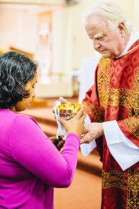 Receiving communion from the chalice